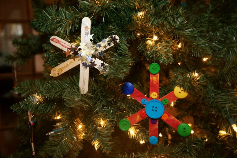 homemade popsicle snowflake ornaments on tree